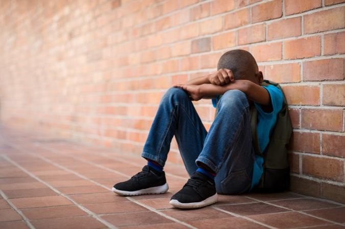 Young sad boy at school