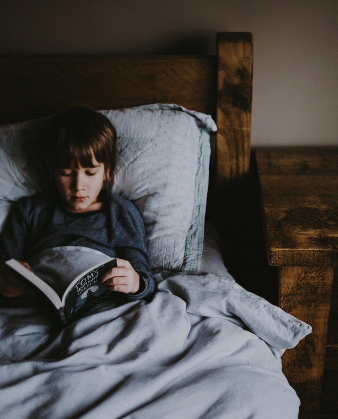 child reading in bed